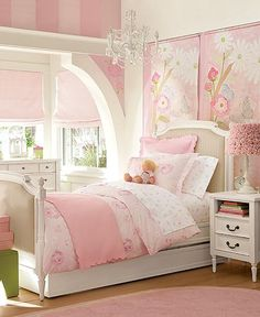 love the painted panels above the bed and the striped wall. princess pink