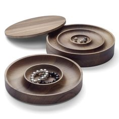This walnut jewellery case by Munich accessory designer Saskia Diez for German brand e15 separates jewels within carved concentric circles. Love.