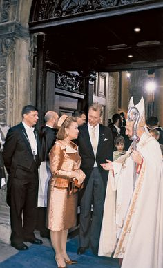 On leaving the cathedral with Archbishop Fernand Franck.