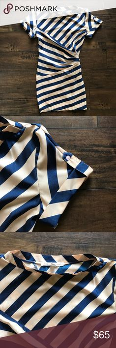 Diane von Furstenberg Silk Stripe Tie Back Dress Diane von Furstenberg Striped Dress  Boat Neckline  Pink and Navy  Short Sleeves with Tabs  Tie Back Waist  Size 8  Shoulder to Shoulder 17, Bust 38, Waist 30, Hips 38 and Dress Length 35.5  100% Silk  Dry Clean Diane Von Furstenberg Dresses