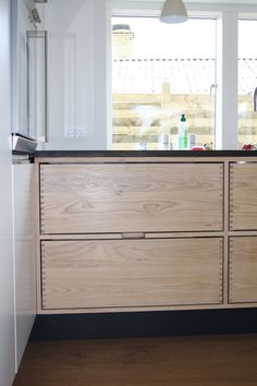 Beautiful handmade kitchen by RUM4. Cabinet and huge drawers in solid ash. Kitchen top in dark oiled oak.  Wall with integrated dish washer,...