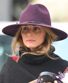 Olivia Palermo wears the Reiss Mimi trilby hat while walking Mr. Butler in Brooklyn, New York