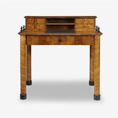 A Biedermeier parcel-ebonized cherrywood desk, Attributed to Josef Danhauser, circa 1820