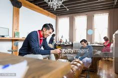 Stock Photo : Entrepreneur using mobile phone in creative office space