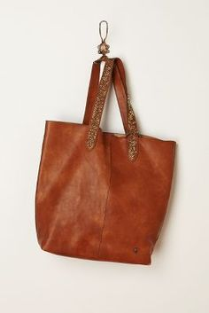 Peppermint & Plaid...love this strappy sequin brown leather bag from Anthropologie.