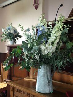 Posy barn wild jug of flowers in church
