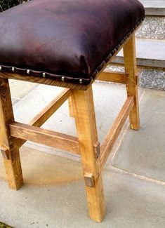 I want my husband to make this!  DIY Furniture Plan from Ana-White.com  How to build a no sew nailhead leather upholstered stool. Free step by step plans. This plan shows how to build with pocket holes.