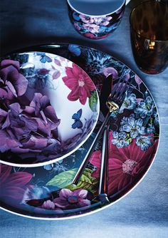 Ceramics decorated with opulent blooms, animal-print glassware and gothic-style table pieces create an individual and daring dining collection.