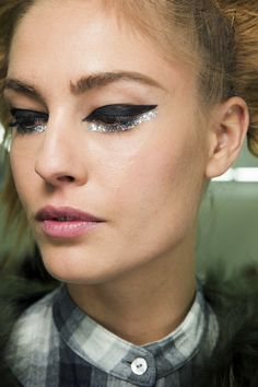 backstage at Chanel S/S 2014 #winged #eyeliner #glitter #beauty #makeup