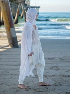 """""""Soft and gentle beautiful white shawl will serve you as a wonderful ritual robe or kimono. It is handmade from an upcycled pure white cotton knits fabric. We made it in two option: plain kimono and hooded kimono style. Both styles look great and can be wrapped around the body for the meditation, silent sitting, sound and ceremony journeys. The source of fabric was limited and only a few pieces are being made from it. Material: upcycled poly/cotton knits. This fabric is very soft. It stretches a Samurai Pants, Post Apocalyptic Fashion, Male Kimono, White Shawl, Soft And Gentle, Kimono Fashion, Looks Great, Kimono Style, Pure Products"""