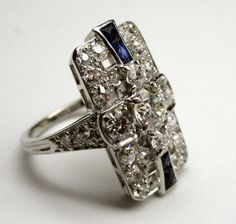 A Gorgeous Art Deco Ring made of platinum, diamonds and sapphires. From SummitJewelers on Etsy.