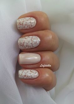 Stunning Lesly Stamping Nail Art - Gorgeous pearlescent nails with a petal & leaf stamp design - perfect for the white & nude nail trends this season #AW14...x