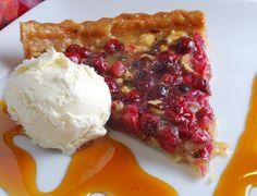 Fresh sliced hazelnut carnberry tart with vanilla ice cream
