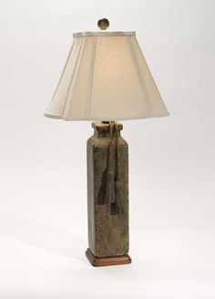 River Run Table Lamp Western Lamps - A braided leather tassel decorates the lamp base. Due to the nature of the special glaze, the color of each lamp will vary. From one of our superior quality collections and made in the USA.
