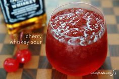 Break tradition with a cherry whiskey sour      4 maraschino cherries     4 oz Jack Daniels whiskey     1 Tbsp lemon juice     1 Tbsp maraschino cherry syrup     ice
