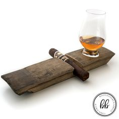 Ex-whisky stave cigar and glencairn glass holder . This product is intended to hold a cigar and one glencairn whisky nosing glass ounce capacity glass). Perfect presentation and usage for a night with your cigar and whisky. Check out my Etsy page for ot Cigar Ashtray, Cigar Humidor, Cigar Bar, Cigars And Whiskey, Good Cigars, Pipes And Cigars, Zigarren Lounges, Cigar Holder, Barrel Projects