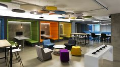Cubby, cushioned open seating that serves dual purpose for small meetings and eating lunch. Reflect Momo colors.