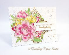 To color the blooms, I stamped each different layer of color on the leaves and blooms.  I have a couple of very light pink inks but the only one I really like for multi-layer stamping is Distress Ink in Spun Sugar.  It is a cool pink tone rather than a warmer tone such as Sweet Blush or Pale Peony.  For the first (and lightest layer) I stamped twice using the Spun Sugar Distress Ink on the large blooms and then the 2nd and 3rd layers using Lovely Lady and Hibiscus Burst Ink.  I stamped the…
