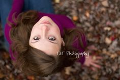 http://tandtphotography.blogspot.com/ - great unique perspective on this senior photo pose