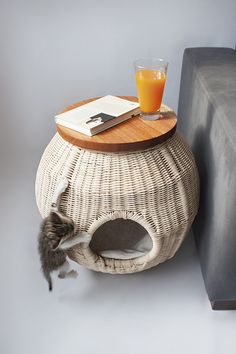 Wicker nightstand / kitten house / climbing gym.   36 Pieces Of Mod Pet Furniture Nicer Than Your Actual Furniture