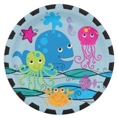 Our Under the Sea paper plates are perfect for ocean and sea theme birthday parties but can be used for many other occasions or for every day use as well! These colorful, fun ocean theme paper plates feature a green octopus, pink jellyfish, pink starfish, lavender seahorse, orange crab, purple fish, ocean waves, a big blue whale with waterspout, and black trim around the plate edge!