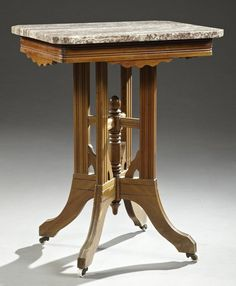 American Victorian Carved Walnut And Tennessee Brown Marble Top Lamp Table   c.1890