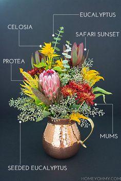 Make a floral arrangement full of fall flowers. #DIY