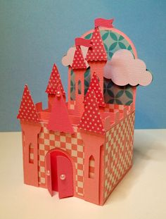 Courtney's gorgeous magical castle is made of adorable patterned paper with floating clouds!  This is the perfect card for that sweet little girl who loves to play make believe and is a princess at heart!   Or change out the colors for a boy and let him be the mighty dragon slayer and master of his castle!  Whatever you need, find this in BOX CARDS SVG KIT!