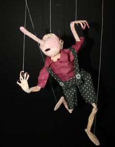 Pinocchio marionette, made from paper then painted. By Layla Holzer