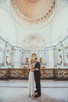 Couple kissing under the gorgeous ceiling at San Francisco City Hall  Photography: IQphoto - iqphoto.com  Read More: http://www.stylemepretty.com/little-black-book-blog/2014/04/29/intimate-elopement-at-san-francisco-city-hall/