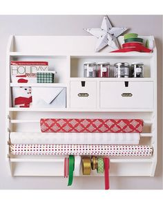 What a great way to store all of that holiday wrapping supplies! Buy it here: http://www.bhg.com/shop/pottery-barn-wall-mounted-craft-organizer-p505c39ce82a71c80fdfde74c.html