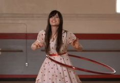 "Zooey Deschanel's Polka dot dress from ""In the Sun"" filmclip.  Outfit Details: http://wwzdw.com/z/1843/ #WWZDW"