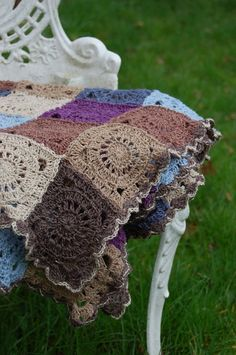 I would take up crochet to make this. Love the circle/square pattern, love the old world natural colours and love the hand spun texture of the wool.