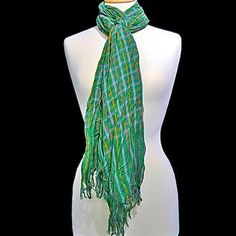 You'll have fun finding new ways to tie this scarf - it's long enough to use in a multitude of ways!  A bright and vivid shade of green is the primary color - accented with a checkered pattern in multicolors.