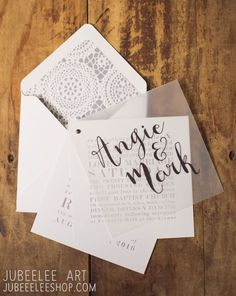 modern gray and white wedding invitation booklet, simple design with calligraphy vellum overlay