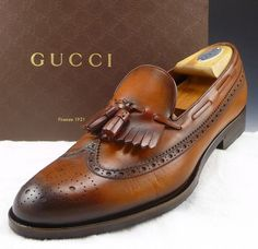 GUCCI. WINGTIP TASSEL LOAFERS.