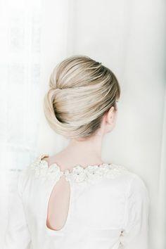 LOVE Sleek modern wedding updo with romantic lace wedding dress