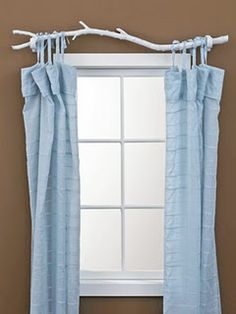 homemade curtain rod using a tree branch - (i have done this before in natural shades in a rustic/cabin home; painted white like this with a bird perched atop it is very cute and whimsical in a child's room or in a relaxed cottage decor ~TA)