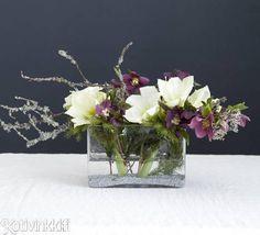 Kotivinkin ohjeen avulla teet joulun kukille kauniin oksa-asetelman. Kukista ja oksista saat näyttävän joulukoristeen joulupöytään.