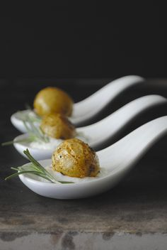 Appetizers - Tiny Rosemary Roasted Potatoes, skewered with a twig of rosemary, individually served in its own little dish on a bed of onion & sour cream sauce.