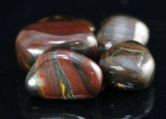 Tiger Iron is a wonderful mixture of Jasper, Hematite and Tiger's Eye. It comes from Australia and South Africa. In addition to carrying all of the traits of Jasper, Tiger's Eye and Hematite, it is a fabulous stone for people who take on other people's emotions. It helps with family stress, change, vitality and survival instincts. Tiger Iron is good for the blood, muscles, prolonged illness, broken bones, leg cramps and fractures.