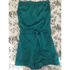 Romper Never worn, 100% polyester, buttons and zips down the side, has a belt The Limited Dresses