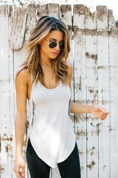 A trapeze-style racerback tank, fitted through the bust and relaxed through the waist, with a flowy asymmetrical hem. Cut to flatter, it's the perfect shape. Color: White Size: S/M (0-4) M/L (6-10) S/