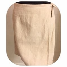 "Cute Beige Linen Wrap Skirt This cute & fresh beige linen wrap skirt from Ann Taylor is a perfect spring and summer piece. The skirt length is 18"", the waist is approx 14"" measured flat across while the inside button is buttoned. 100% linen. Versatile, perfect for day or evening, work or play & easily dressed up or down. The skirt is preloved and in excellent used condition! Ann Taylor Skirts"