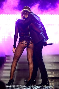 Beyoncé & Jay Z onstage at the 56th Grammy Awards.