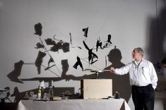 Shadow art william kentridge:rotating the objects changes the shadow and eventually forms A figure, object or portrait. (plato's allegory of the cave)
