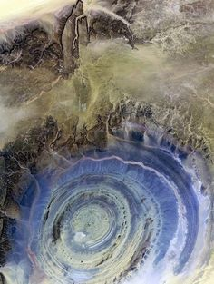 EYE OF AFRICA - MAURITANIA In the Sahara   Desert of Mauritania. This natural phenomenon is a richat structure caused by   the dome shaped symmetrical uplifting of underlying geology now made visible by   millennia of erosion.  This can be seen on google earth.  The earth is amaze   balls.  That is all.