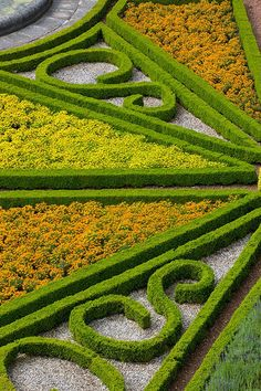 Parterre garden at Sledmere Gardens, nr. Driffield, East Yorkshire www.sledmerehouse.com Photography by Clive Nichols