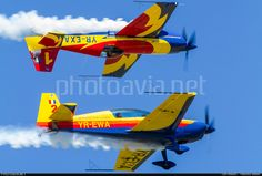 The Hawks of Romania - Mirrorflight at Strejnic Airfield. George Rotaru on top (Extra 330SC), Attila Goger below (Extra 300L)