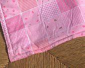Pretty pink cot blanket